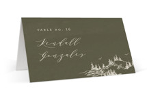 This is a green wedding place card by Helen Halik called into the mountains with standard printing on signature in placecard.
