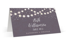 This is a purple wedding place card by Hooray Creative called Garden Lights with standard printing on signature in placecard.