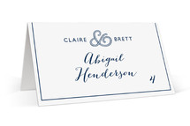 This is a white wedding place card by Jill Means called Rope Ampersand with standard printing on signature in placecard.