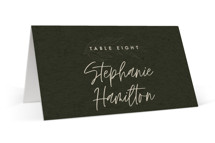 This is a green wedding place card by Lindsay Stetson Thompson called delicate seal with standard printing on signature in placecard.