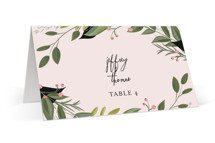 This is a pink wedding place card by Susan Moyal called Vines of Green with standard printing on signature in placecard.