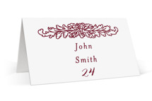 This is a red wedding place card by Nazia Hyder called Ornate with standard printing on signature in placecard.