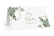 This is a white wedding place card by Susan Moyal called Succulent Surround with standard printing on signature in placecard.