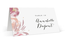 This is a pink wedding place card by Bonjour Paper called Grand Bloom with standard printing on signature in placecard.