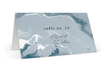 This is a blue wedding place card by Alethea and Ruth called swirl with standard printing on signature in placecard.