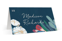 This is a blue wedding place card by Morgan Ramberg called Floral Burst with standard printing on signature in placecard.