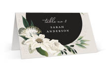 This is a white wedding place card by Susan Moyal called Botanical Ring with standard printing on signature in placecard.