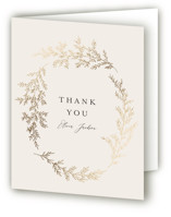 This is a beige wedding thank you card by Carolyn Nicks called entwined branches with foil-pressed printing on strathmore in standard.