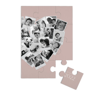 This is a purple custom puzzle by Minted called Collage Heart printing on signature.