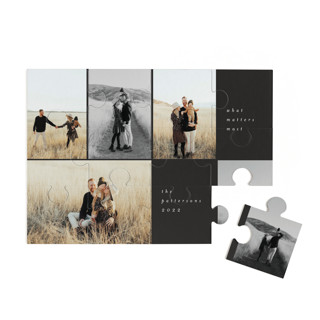 This is a black custom puzzle by Morgan Kendall called Holiday Grid printing on signature in standard.