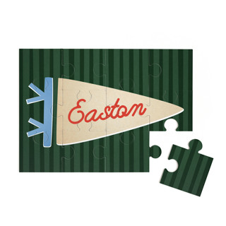 This is a green custom puzzle by Amy Kross called Proud Pennant printing on signature.