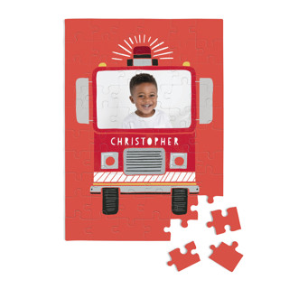 This is a red custom puzzle by Alethea and Ruth called Sound the Alarm Firetruck printing on signature.