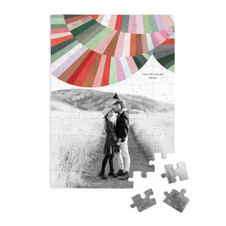 This is a red custom puzzle by melanie mikecz called Fan Out printing on signature.