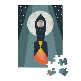 This is a blue custom puzzle by Morgan Kendall called Rocket to the Moon printing on signature.