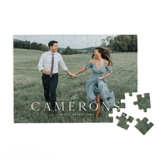 This is a white custom puzzle by Melanie Kosuge called CHIC MINIMAL printing on signature.
