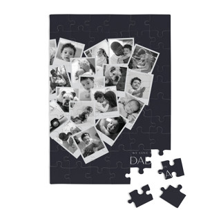 This is a blue custom puzzle by Minted called Dada Collage Heart printing on signature in standard.