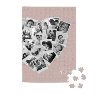 This is a purple custom puzzle by Minted called Collage Heart printing on signature in standard.