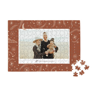 This is a brown custom puzzle by Elly called Cosmic printing on signature in standard.