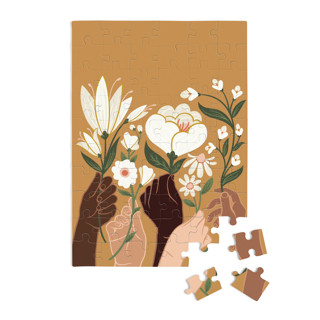 This is a orange puzzle by Jamie Alexander called Helping Hands in standard.