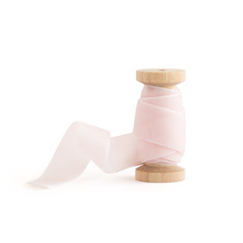 This is a pink wedding ribbon by Minted called Blush Velvet.