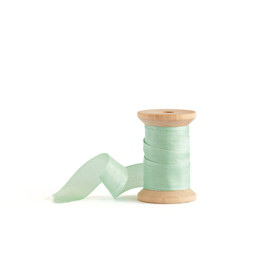 This is a green wedding ribbon by Minted called Mint Shimmer.