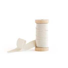This is a beige wedding ribbon by Minted called Champagne & Gold Flecked Grosgrain.