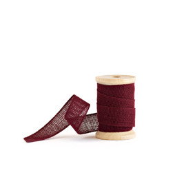 This is a red wedding ribbon by Minted called Burgundy Loose Weave Cotton.