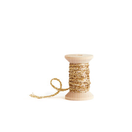 This is a gold wedding ribbon by Minted called Glitter Cord Gold.