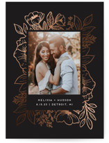 This is a black foil stamped save the date card by Genna Cowsert called Cut Flowers with foil-pressed printing on smooth signature in grand.