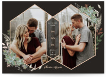 This is a black foil stamped save the date card by Susan Moyal called Intertwined with foil-pressed printing on signature in grand.