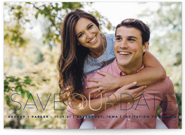 This is a landscape bold and typographic, full bleed photo, modern, blue Save the Dates by fatfatin called Rings Of Love with Foil Pressed printing on Signature in Classic Flat Card format. A modern classic design featuring a full bleed ...