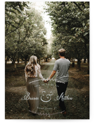This is a portrait classic and formal, grey Save the Dates by Lisa McLean called Elegant Scenery with Foil Pressed printing on Smooth Signature in Classic Flat Card format. Delicate foil pressed branches frame your scripted names in this elegant ...
