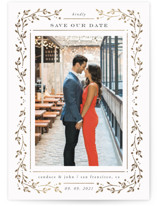 This is a white foil stamped save the date card by Ana de Sousa called Fairytale with foil-pressed printing on smooth signature in standard.