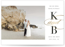 This is a white foil stamped save the date card by Kelly Schmidt called Elegant Initials with foil-pressed printing on smooth signature in standard.