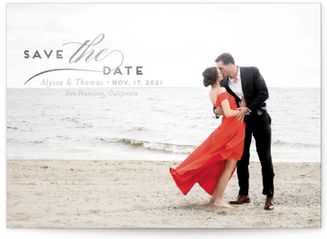 This is a landscape classic and formal, grey Save the Dates by Griffinbell Paper Co. called Contemporary Classic with Foil Pressed printing on Smooth Signature in Classic Flat Card format. Simple and classic typography overlays a full bleed photo