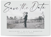 This is a grey foil stamped save the date card by AK Graphics called Flash Dance with foil-pressed printing on smooth signature in standard.
