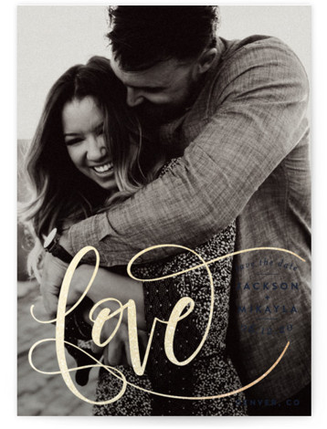 """This is a portrait hand drawn, modern, blue, gold Save the Dates by Amy Payne called Flourished Love with Foil Pressed printing on Smooth Signature in Classic Flat Card format. Hand lettered """"love"""" in foil surrounds the custom information in ..."""