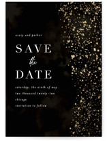 This is a black foil stamped save the date card by Angela Marzuki called glistening stardust with foil-pressed printing on doublethick in standard.
