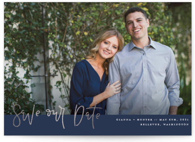 This is a landscape classic and formal, blue, silver Save the Dates by Olivia Goree called Simply Panoramic with Foil Pressed printing on Signature in Classic Flat Card format. A foil pressed save the date design featuring a handlettered greeting ...