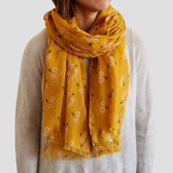 This is a yellow sheer scarf by Alex Roda called Mustard bouquet.