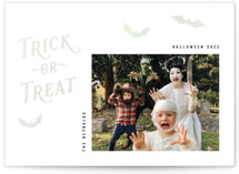 This is a black gloss press holiday card by Hooray Creative called Trick-or-Treat with gloss-press printing on signature in standard.