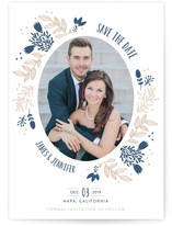 This is a blue save the date by Creo Study called elliptical with letterpress printing on bright white letterpress paper in standard.