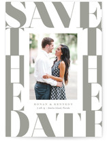 This is a grey save the date by Jennifer Wick called stacked letters with letterpress printing on bright white letterpress paper in standard.