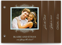 This is a brown save the date photo minibook card by Splendid Press called Ornate with standard printing on strathmore in minibook.