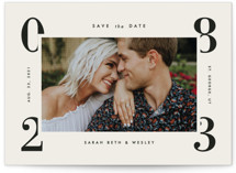 This is a grey petite save the date by Amy Kross called Cornered with standard printing on smooth signature in petite.