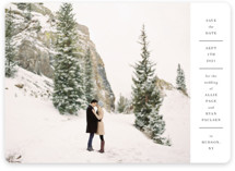 This is a white save the date magnet by Toast & Laurel called Hudson with standard printing on magnet paper in magnet.