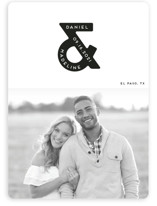 This is a white save the date magnet by Gwen Bedat called Ampersand us with standard printing on magnet paper in magnet.