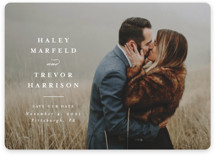 This is a white save the date magnet by Lea Delaveris called Simple side with standard printing on magnet paper in magnet.