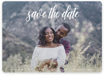 This is a white save the date magnet by Kate Ross called mystic with standard printing on magnet paper in magnet.