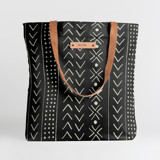 This is a black snap tote by Erin Deegan called mud cloth organic.